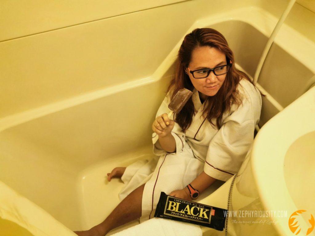 Zephyriousity in a bathtub eating Meiji Black Ice Cream